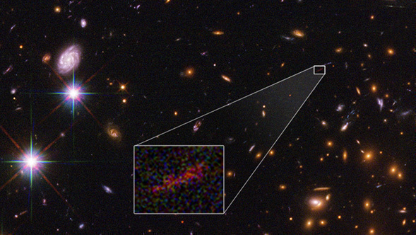 This Hubble Space Telescope image shows the farthest galaxy yet seen in an image that has been stretched and amplified by a phenomenon called gravitational lensing. Credits: NASA , ESA, and B. Salmon (STScI)