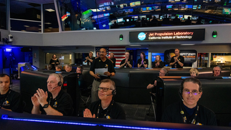 Spitzer Project Manager Joseph Hunt stands in Mission Control at NASA's Jet Propulsion Laboratory in Pasadena, California, on Jan. 30, 2020, declaring the spacecraft decommissioned and the Spitzer mission concluded.